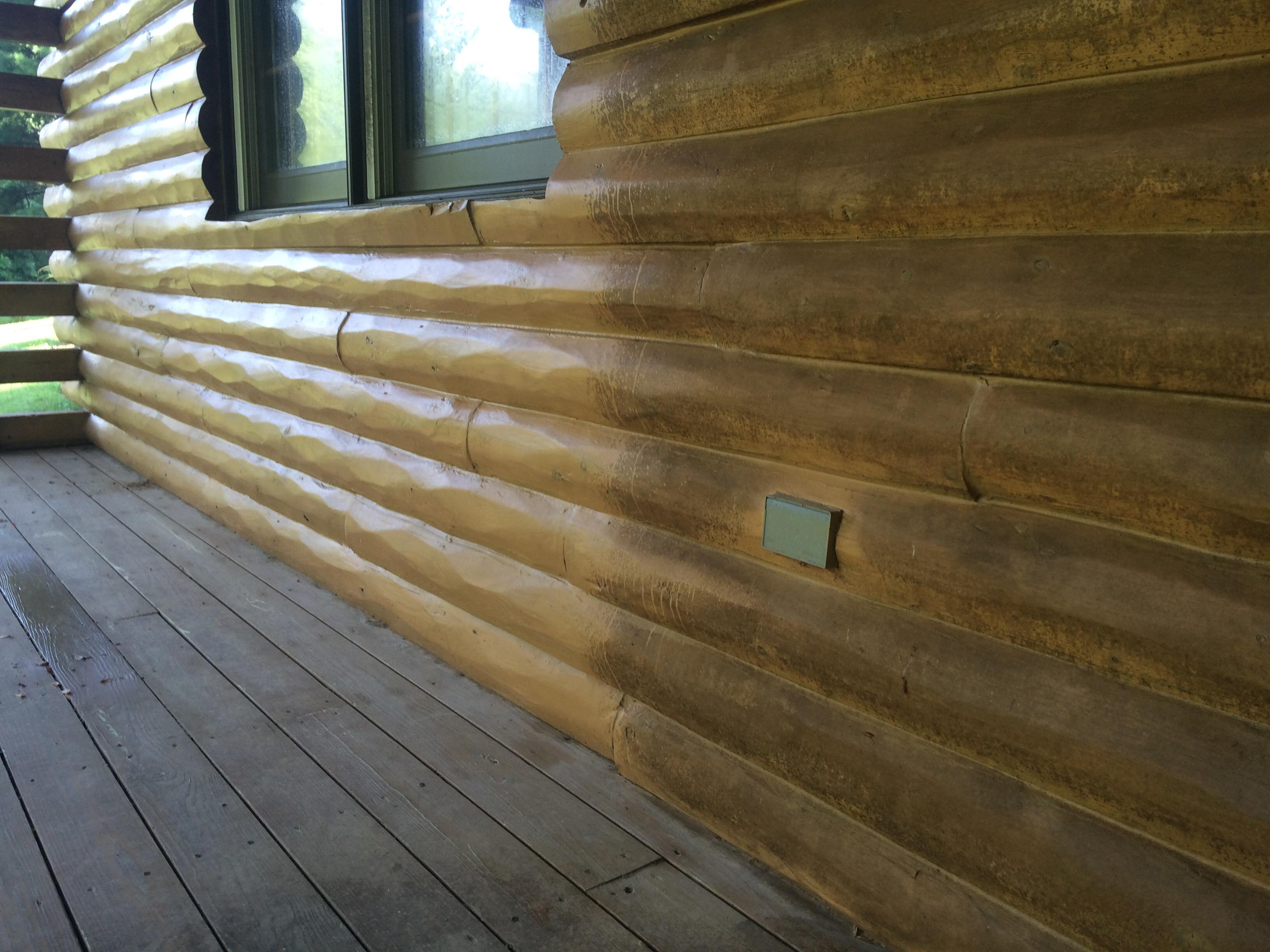 Washing Mildew on a log cabin